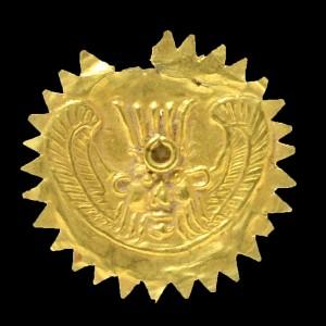 Золотая голова египетского божества Беса который был популярен у финикийцев