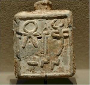 Гирька из свинца с символом Таниты